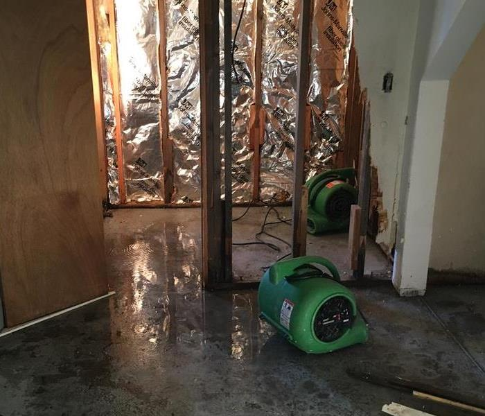 water damaged house with dehumidifiers set out